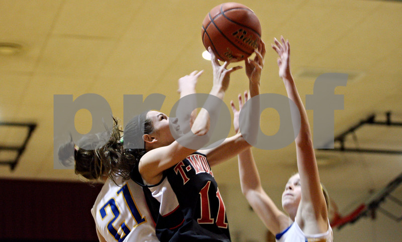 Rob Winner – rwinner@daily-chronicle.com<br /> <br /> Indian Creek's Ariel Russell tries to retrieve her own rebound during the first quarter of the Timberwolves Little Ten Conference tournament game against Somonauk on Monday night. Somonauk went on to defeat Indian Creek, 37-26.