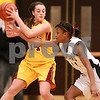 Kyle Bursaw – kbursaw@daily-chronicle.com<br /> <br /> Sycamore's Keri Treml tries to steal the ball away from Morris' Leslie Claire in the fourth quarter of the game. Morris defeated Sycamore 27-23 on Friday, Jan. 7, 2011.