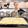 Kyle Bursaw – kbursaw@daily-chronicle.com<br /> <br /> Mary Wyzard stirs up a batch of chicken noodle soup at Cathedral of Praise prior to serving the first dinner there in DeKalb, Ill. on Tuesday, Feb. 15, 2011.