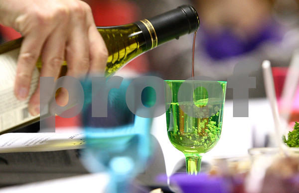 Kyle Bursaw – kbursaw@daily-chronicle.com<br /> <br /> One of about forty people taking part in the Passover Seder pour some wine at Congregation Beth Shalom in DeKalb, Ill. on Tuesday, April 19, 2011,