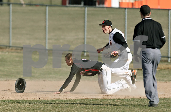 Rob Winner – rwinner@daily-chronicle.com<br /> <br /> Huntley's Nick Kostalek (left) is tagged out by DeKalb's Brian Sisler to end the top of the second inning on Wednesday, March 30, 2011 in DeKalb, Ill. Huntley defeated DeKalb, 11-8.