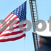 Kyle Bursaw – kbursaw@shawmedia.com<br /> <br /> DeKalb Fire Chief Bruce Harrison looks to the flag as a moment is taken to remember the events of Sept. 11 at the start of Kite Fest on the Northern Illinois University campus on Sunday, Sept. 11, 2011.