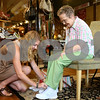 Kyle Bursaw – kbursaw@daily-chronicle.com<br /> <br /> Stomp employee Ellen Downing (left) helps customer Mary Barrowman lace up a pair of shoes in Sycamore, Ill. on Thursday, May 12, 2011.