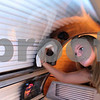 Kyle Bursaw – kbursaw@daily-chronicle.com<br /> <br /> Amy Sheahan, a tanning consultant at Dynamic Tanning, wipes down a tanning bed between uses at the Sycamore road location in DeKalb, Ill. on Tuesday, March 8, 2011.