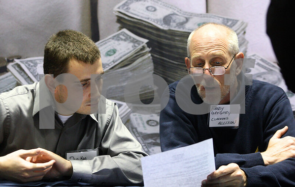 Kyle Bursaw – kbursaw@shawmedia.com<br /> <br /> Dan Kuc and Randy Gregory of Cummings-Allison Corp look over an NIU student's resume at the annual Fall Jobs Fair at the Convocation Center on Wednesday, Oct. 19, 2011.