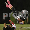 Rob Winner – rwinner@shawmedia.com<br /> <br /> Yorkville's Ilir Emini trips up Kaneland receiver Quinn Buschbacher (22) after a reception during the first quarter in Maple Park, Ill., on Friday, Oct. 7, 2011.