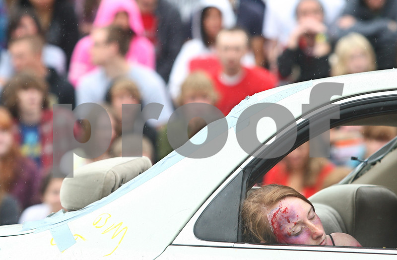 Kyle Bursaw – kbursaw@daily-chronicle.com<br /> <br /> During a simulation for Sycamore high school students to show the devastation of drinking and driving, Sycamore student Katie Woolsey pretends to be dead and is later zipped into a bodybag and taken away by the coroner on Wednesday, May 18, 2011.