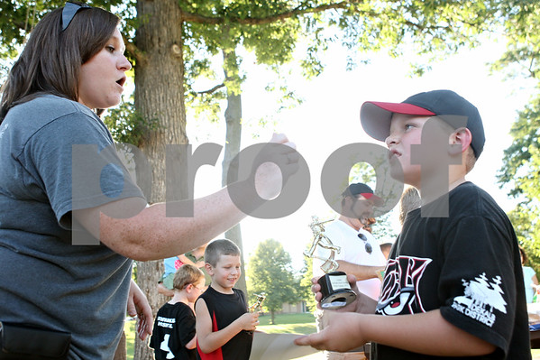 Rob Winner – rwinner@daily-chronicle.com<br /> <br /> Interpreter Erin Peterman (left) uses American Sign Language to communicate with Caleb Zapadinsky during a barbecue at Hopkins Park in DeKalb on Monday.