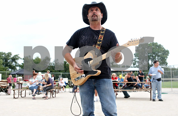 Rob Winner – rwinner@daily-chronicle.com<br /> <br /> Craig Cox of the band Back Country Roads stands in front of the stage for a sound check before performing as Cortland Summer Fest kicked off at Cortland Community Park on Friday evening.