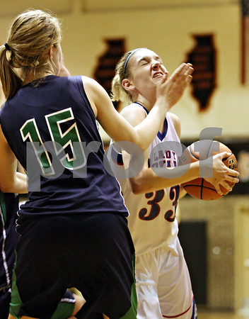 Rob Winner – rwinner@daily-chronicle.com<br /> <br /> Hinckley-Big Rock's Tess Godhardt is fouled on her way to the basket during the third quarter of the IHSA Class 1A DeKalb Super-Sectional on Monday February 21, 2011 in DeKalb, Ill. River Ridge-Scales Mound defeated Hinckley-Big Rock, 43-28.
