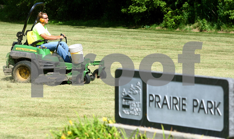Kyle Bursaw – kbursaw@daily-chronicle.com<br /> <br /> Zach Bock, of the DeKalb Parks Department, mows part of Prairie Park on Thursday, July 14, 2011.