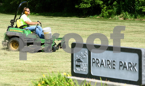 Kyle Bursaw – kbursaw@daily-chronicle.com<br /> <br /> Zach Bock, of the DeKalb Parks Department, mows part of Prairie Park on Thursday, July 14, 2011.
