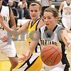 Kyle Bursaw – kbursaw@daily-chronicle.com<br /> <br /> Sycamore's Ashley Berlinski loses control of the ball while being defended by Sterling's Aleena Hammelman during the first half of the game between Sycamore and Sterling at Sycamore  high school on Tuesday, Jan. 4, 2011.
