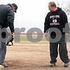 Rob Winner – rwinner@daily-chronicle.com<br /> <br /> Indian Creek coach Paul Waitkoss talks with the home plate umpire during the bottom of the second inning in DeKalb, Ill., on Wednesday, March 23, 2011. DeKalb went on to defeat Indian Creek in five innings, 16-4.