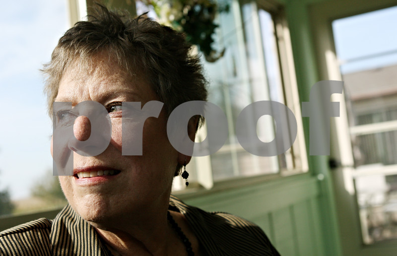Rob Winner – rwinner@shawmedia.com<br /> <br /> Karen Schweitzer looks out the window of a sun room at her home in DeKalb on Friday afternoon. Schweitzer was diagnosed with a rare glandular cancer that affected her right eyelid in July 2010.