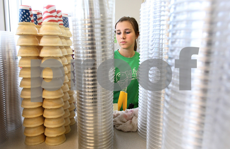Kyle Bursaw – kbursaw@daily-chronicle.com<br /> <br /> Kelli Phelan, 17, scoops up an order inside Ollie's Frozen Custard in Sycamore, Ill. on Friday, May 6, 2011.