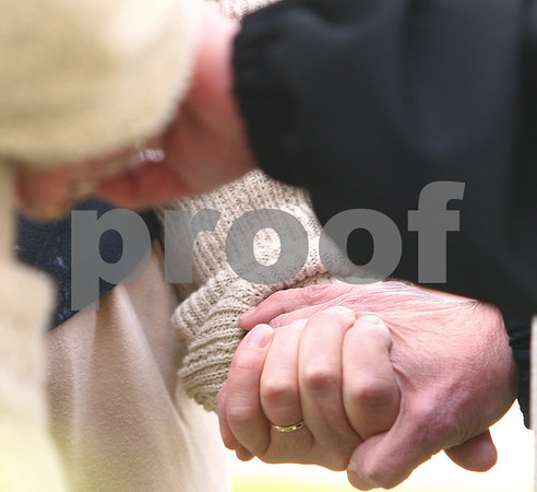 Kyle Bursaw – kbursaw@daily-chronicle.com<br /> <br /> Near the end of the ceremony, attendees join hands in smaller prayer circles during the National Day of Prayer event at the DeKalb County Courthouse in Sycamore, Ill. on Thursday, May 5, 2011.