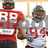 Rob Winner – rwinner@shawmedia.com<br /> <br /> Northern Illinois tight end Tim Semisch (88) and defensive tackle Donovan Gordon pass each other during practice in DeKalb, Ill. on Tuesday, Oct. 4, 2011.