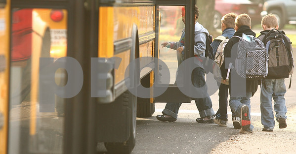Kyle Bursaw – kbursaw@shawmedia.com<br /> <br /> Students board a bus at Founders Elementary headed for another school in the district on the morning of Thursday, Sept. 29, 2011.