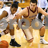 Kyle Bursaw – kbursaw@shawmedia.com<br /> <br /> Morris' Jake Olson and Kaneland's Thomas Williams chase down a loose ball in the third quarter of their game in the Plano Christmas Classic in Plano, Ill. on Tuesday, Dec. 27, 2011. The Knights defeated the Redskins 50-44.
