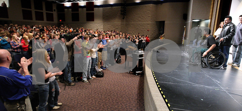 """Kyle Bursaw – kbursaw@daily-chronicle.com<br /> <br /> Belvidere North wrestler Heriberto """"Eddie"""" Avila and his family are greeted in the auditorium of Genoa-Kingston high school with a standing ovation by the students on Wednesday, Feb. 23, 2011. Avila ended up having his leg amputated after an unfortunate accident while wrestling against Genoa-Kingston.<br /> The Genoa-Kingston community raised more than $5,700 to give to the Avila family to help them through the tragedy."""