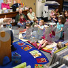 Kyle Bursaw – kbursaw@daily-chronicle.com<br /> <br /> Theresa Winterbauer, the youth services manager at DeKalb Public Library, reads a book to children during toddler time on Wednesday, April 13, 2011.