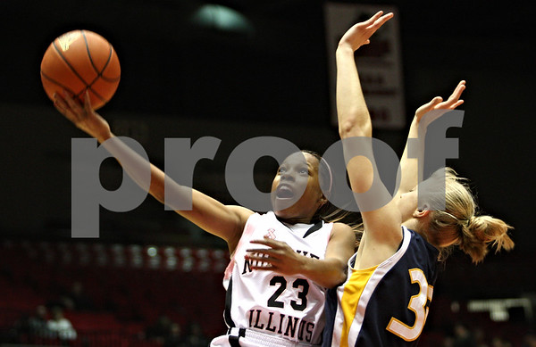 Rob Winner – rwinner@daily-chronicle.com<br /> <br /> Northern Illinois guard Marke Freeman (23) takes a shot while Toledo center Yolanda Richardson (35) defends during the first half on Saturday, Feb. 26, 2011 in DeKalb, Ill.