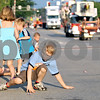 Rob Winner – rwinner@daily-chronicle.com<br /> <br /> 7-year-old Ben Grych, of DeKalb, collects candy during the Kishwaukee Fest Parade on Friday, July 29, 2011.