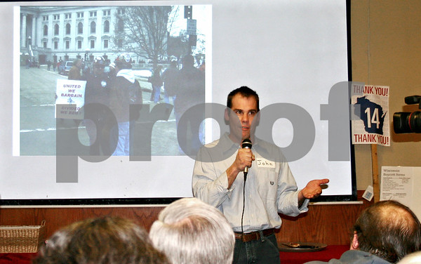 """John Laesch, union carpenter and political activist, speaks to a group of close to 70 people at a """"solidarity social"""" Thursday at Pizza Pros in DeKalb. Sponsored by the DeKalb County Democrats, the social was held in support of collective bargaining rights. <br /> <br /> Caitlin Mullen - cmullen@daily-chronicle.com"""