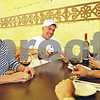 Rob Winner – rwinner@daily-chronicle.com<br /> <br /> Malta resident Doug Canova (center) pours himself a beer at Mediterraneo in DeKalb before dinner with friends, including Amy Kroger (left), on Friday, June 17, 2011. Mediterraneo has had a bring your own bottle license for about a year now.