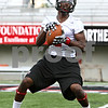 Rob Winner – rwinner@daily-chronicle.com<br /> <br /> Martel Moore pulls in a ball during a drill at practice in DeKalb, Ill. on Friday, Aug. 5, 2011.