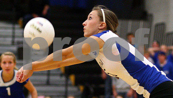Kyle Bursaw – kbursaw@shawmedia.com<br /> <br /> Burlington Central senior Samantha Bohne keeps a ball in play during their match against Sycamore in the Class 3A Volleyball Sycamore Regional Semifinal atSycamore High School on Tuesday, Oct. 25, 2011.