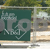 Kyle Bursaw – kbursaw@shawmedia.com<br /> <br /> A pedestrian walks past the construction site of NB&T on Wednesday, Sept. 21, 2011.