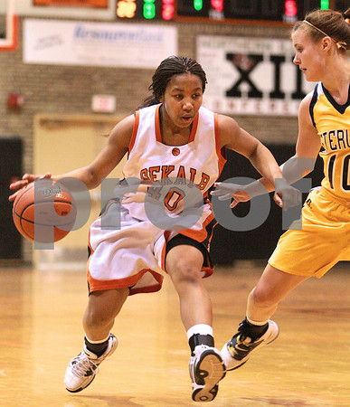 Kyle Bursaw – kbursaw@daily-chronicle.com<br /> <br /> DeKalb's Courtney Patrick slows down and looks for somewhere to pass as  Sterling's Aleena Hammelman defends during their game in DeKalb, Ill. on Saturday, Jan. 29, 2011.