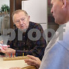 Kyle Bursaw – kbursaw@daily-chronicle.com<br /> <br /> Bill Brackmann shuffles a deck of cards during a round of cribbage while talking with Elmer Anderson at the Sycamore Senior Activity Center on Friday, Jan. 21, 2011.