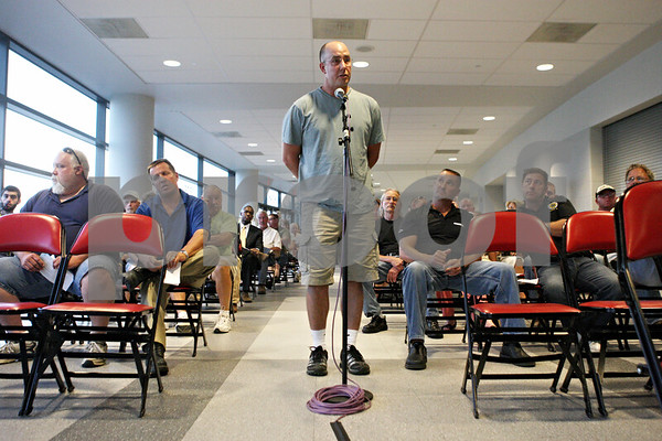 Rob Winner – rwinner@shawmedia.com<br /> <br /> Lance Yednock, of Ottawa and former Northern Illinois graduate, speaks in favor of the toll increases during a public hearing at the Convocation Center in DeKalb on Friday, Aug. 19, 2011.