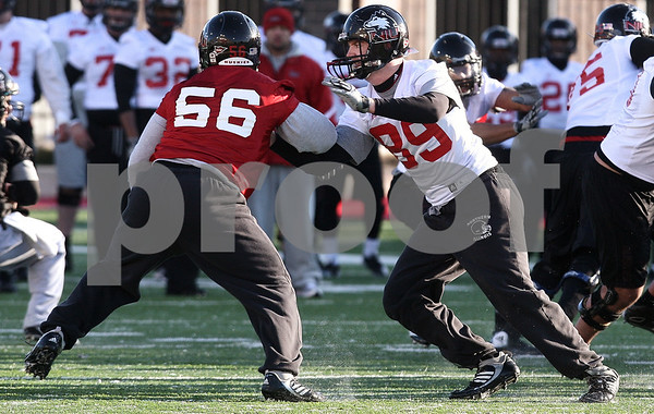 Kyle Bursaw – kbursaw@daily-chronicle.com<br /> <br /> Tight end Jack Marks (89) moves out to block Daniel Green (56) during practice at Huskie Stadium on Thursday, March 24, 2011.