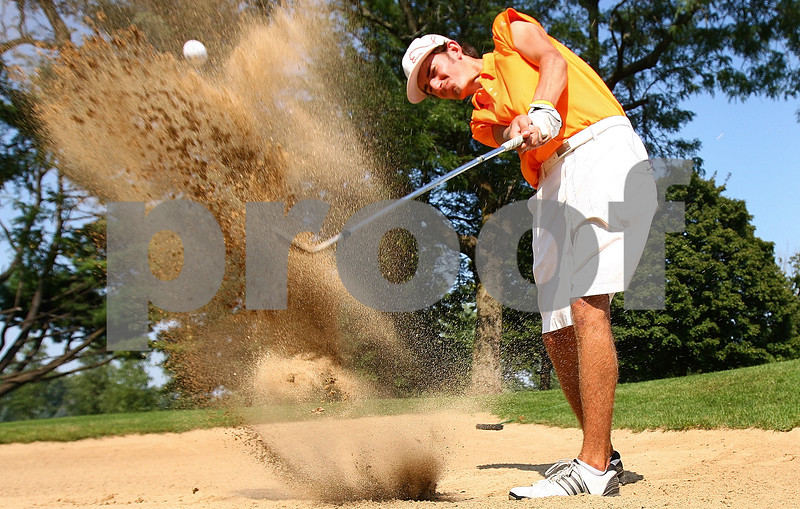 Kyle Bursaw – kbursaw@shawmedia.com<br /> <br /> DeKalb senior Mason Struthers hits out of the sand trap during practice at Kishwaukee Country Club on Thursday, Sept. 1, 2011.
