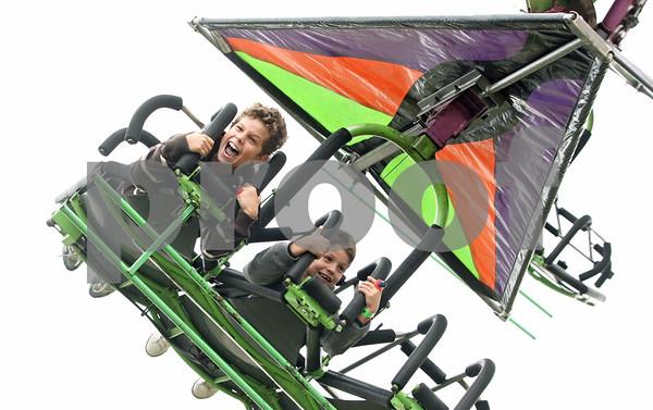 Rob Winner – rwinner@shawmedia.com<br /> <br /> Brothers James Steimel (left), 8, and Michael Steimel, 7, ride the Cliff Hanger as September Fest kicked off at St. Mary School in DeKalb on Friday, Sept. 23, 2011.