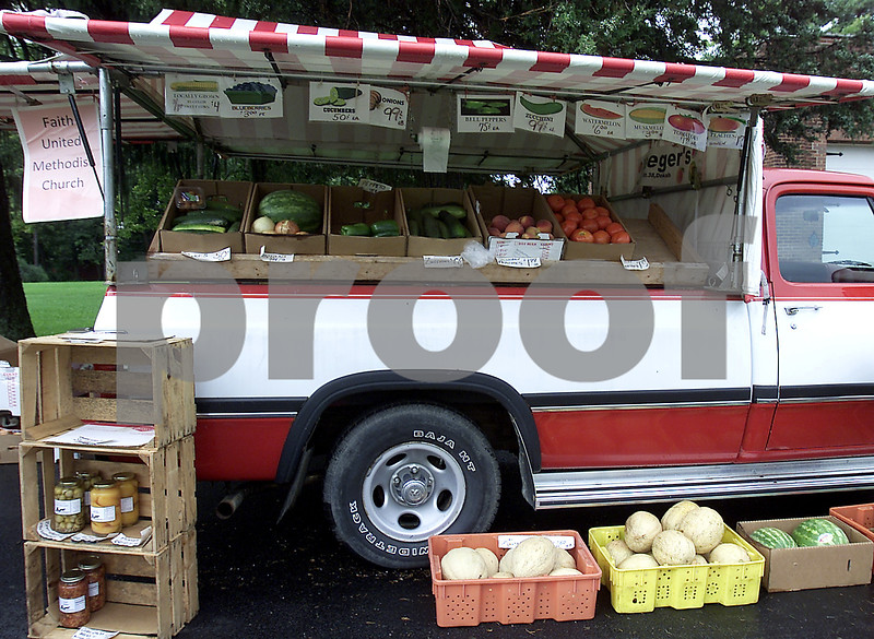 Chronicle photo KATE WEBER<br /> Genoa's Summer Produce Stand has been up and running for three years with all the profits donated to Faith United Methodist Church in Genoa. The fruits, vegetables and Amish goods are purchased from Yaegar's Farm Market in Cortland.