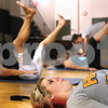 Kyle Bursaw – kbursaw@daily-chronicle.com<br /> <br /> Renee Larson (front) and her mother Barb (left) and sister Jeanine (back) work out while Pilates class instructor Michele Wylde helps Jeanine with her form at Unlimited Performance in Sycamore, Ill. on Thursday, June 30, 2011.