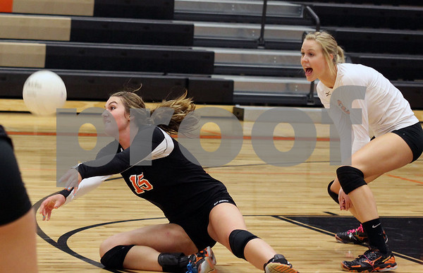 Wendy Kemp - For The Daily Chronicle<br /> DeKalb's Emily Bemis bumps the ball during Saturday's game against Zion Benton.<br /> DeKalb 9/10/11