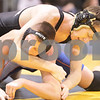 Kyle Bursaw – kbursaw@daily-chronicle.com<br /> <br /> Sycamore's Logan Kein grabs hold of Genoa-Kingston's Mason Rogers. Rogers defeated Kein in their 152 pound weight class match at Sycamore high school on Saturday, Jan. 8, 2011.