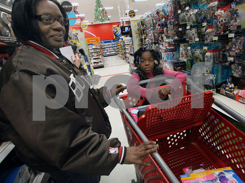Wendy Kemp - For The Daily Chronicle<br /> Sheila Pitts and her daughter, Beyonce, 9, participate in the Shop with a Cop event at Target on Sunday.<br /> DeKalb 12/11/11