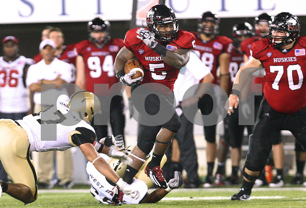 Kyle Bursaw – kbursaw@shawmedia.com<br /> <br /> Northern Illinois running back Jamal Womble (5) breaks through Army defenders and runs for a touchdown during the third quarter to put NIU up 42-6 at Huskie Stadium in DeKalb, Ill. on Saturday, Sept. 3, 2011.