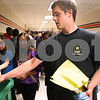 Kyle Bursaw – kbursaw@daily-chronicle.com<br /> <br /> Devin Hershberger discards some of his locker contents during a designated locker clean out at DeKalb High School on Wednesday, May 25, 2011.