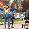 Kyle Bursaw – kbursaw@daily-chronicle.com<br /> <br /> Harold Lave aids children crossing Fourth street at the intersection of Taylor street in DeKalb, Ill. after school on Wednesday, April 27, 2011. Lave has been a crossing guard for five years.