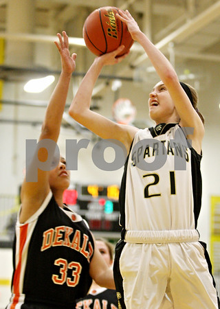 Rob Winner – rwinner@daily-chronicle.com<br /> <br /> Sycamore's Lauren Miller takes a jump shot during the third quarter on Thursday, Feb. 10, 2011 in Sycamore, Ill. Sycamore went on to defeat DeKalb, 34-30.