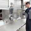 Kyle Bursaw – kbursaw@daily-chronicle.com<br /> <br /> DeKalb firefighter Drew Wells checks lights on the department's ladder truck, which is now more than 20 years old, during a maintenance check on Wednesday, April 6, 2011 at Station no. 1 in DeKalb, Ill.