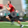 Kyle Bursaw – kbursaw@daily-chronicle.com<br /> <br /> Chandler Harnish sprints during a workout session at Huskie Stadium on Tuesday morning.<br /> <br /> <br /> Tuesday, June 28, 2011.